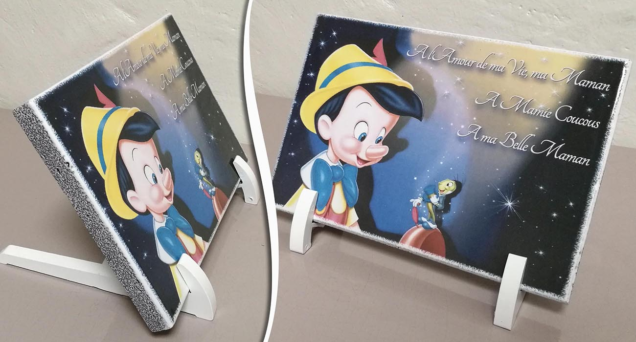 Plaques funeraires en pierre Pinocchio: Réalisation en pierre de lave émaillée
